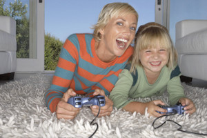 Mother and Daughter Enjoying a Video Game