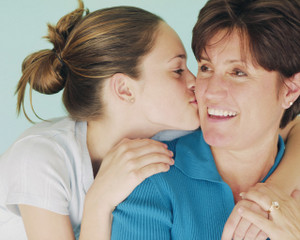 Teen Daughter Kissing Mother